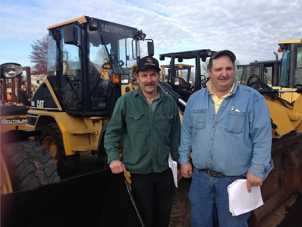 Nelson (L) and Francis Garrow look to purchase a variety of heavy machinery, including this Cat 906 wheel loader.