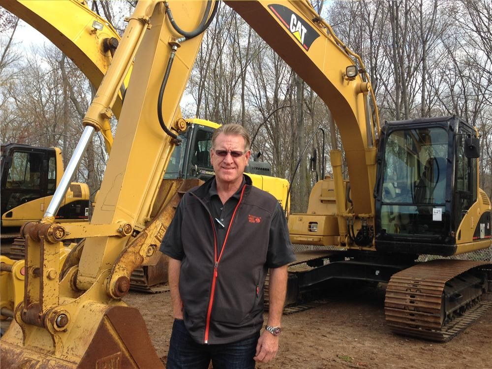 Chris Reseska of PLT in western Mass. considers bidding on this Cat 312C excavator.