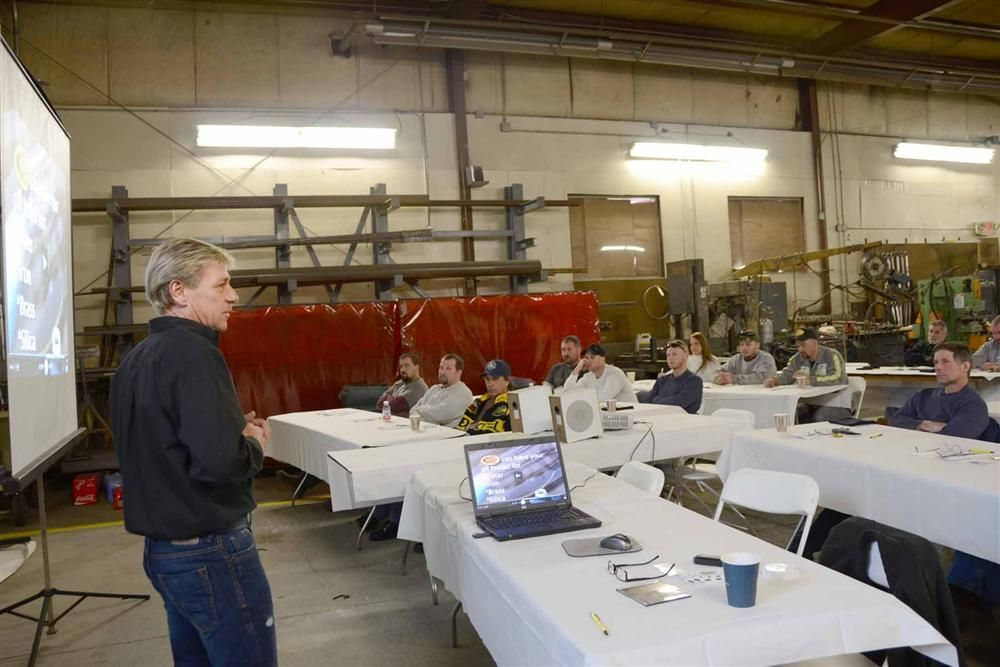 Scott Murphy leads one of the five groups through a Deister Machine Company presentation.