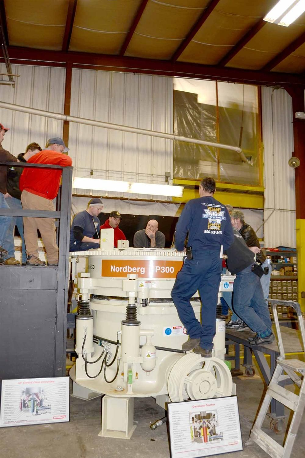 Jamie Zisk and Dave Wentworth hold court from inside an HP300 cone crusher.
