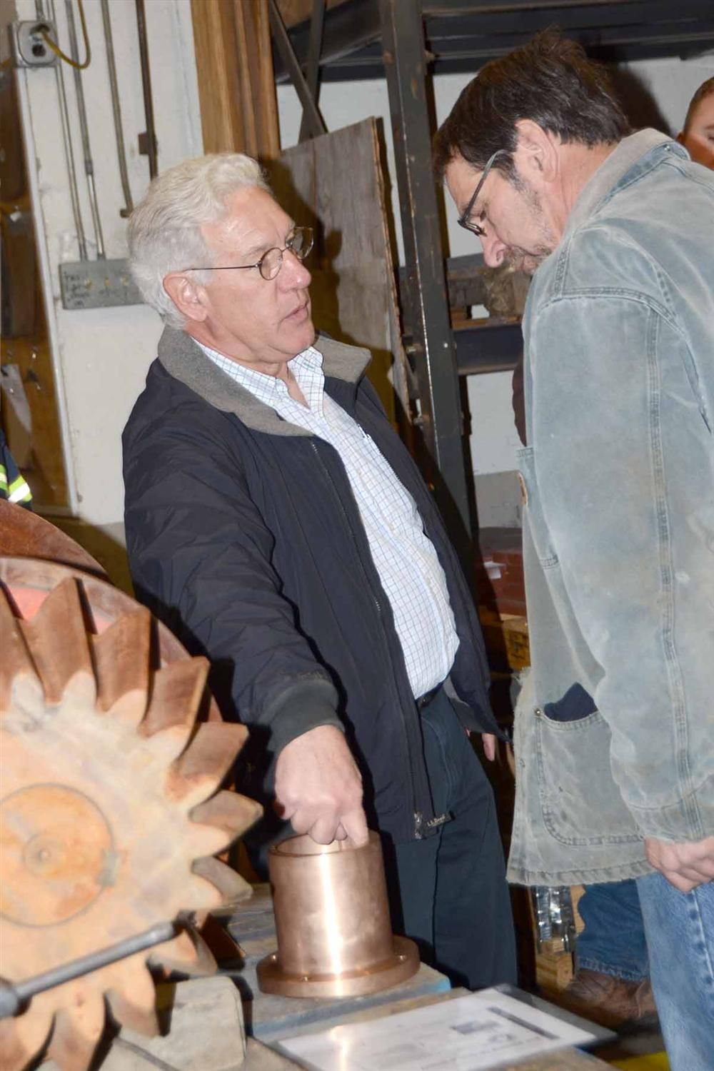 Doug Baker (L) and L E Weed's Al Phillips discuss cone crusher countershaft box bushings.