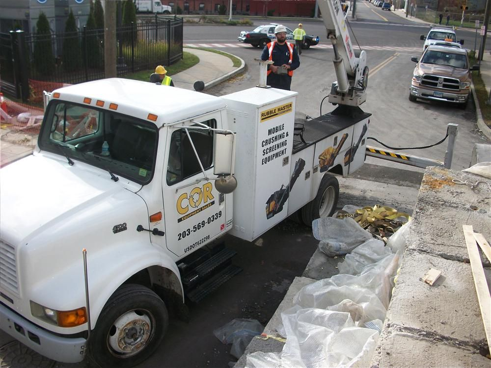 Cavaliere Industries Inc. was contracted by CL&P to provide back up pumping services due to Super Storm Sandy. Anthony Rende operates his service truck crane to place pump in position.