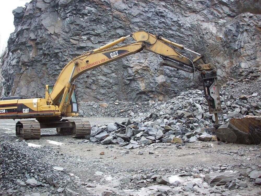 A Gorilla hammer was placed on a newer Cat 325; to add some flexibility to the machine it was installed with a quick coupler and a thumb.