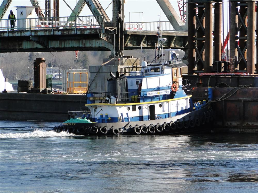 Photo courtesy of Dennis McIntire, Rye, N.H. Tug boat working to keep the barge in place that will receive the center lift span, upon its disconnection.