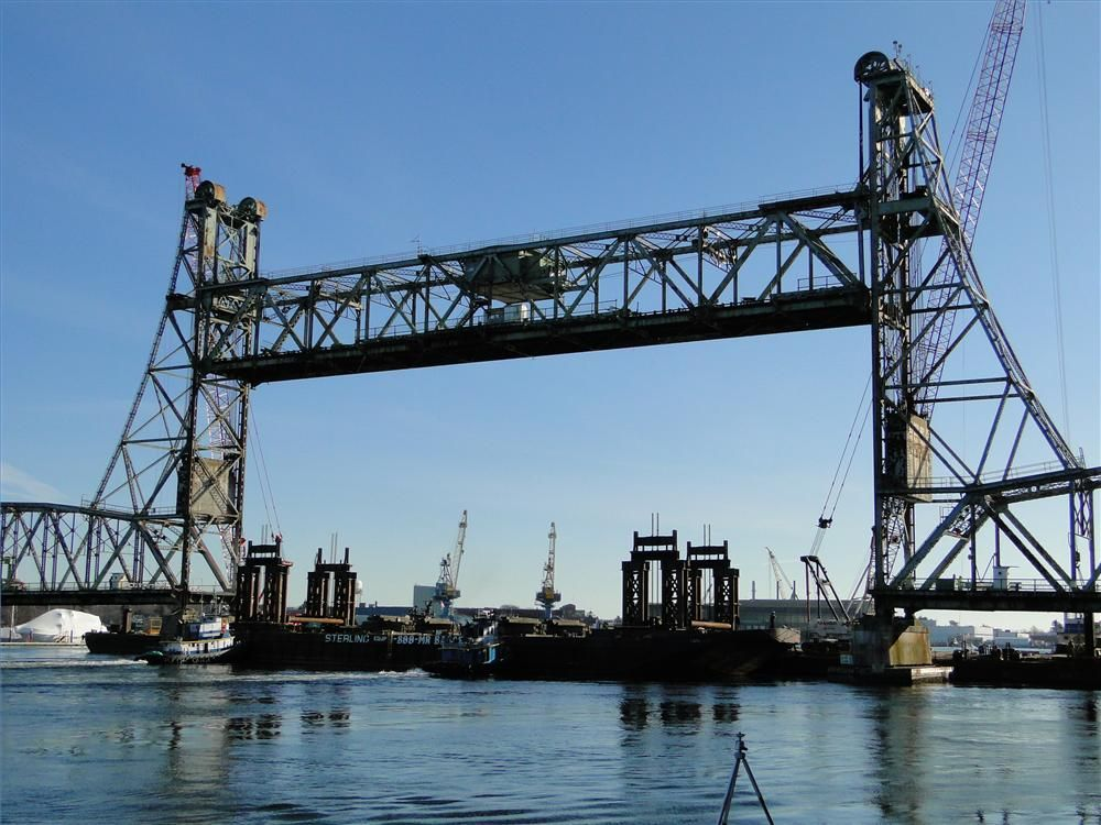Photo courtesy of Dennis McIntire, Rye, N.H. Tugs and barge in place, ready for center lift span to be disconnected.