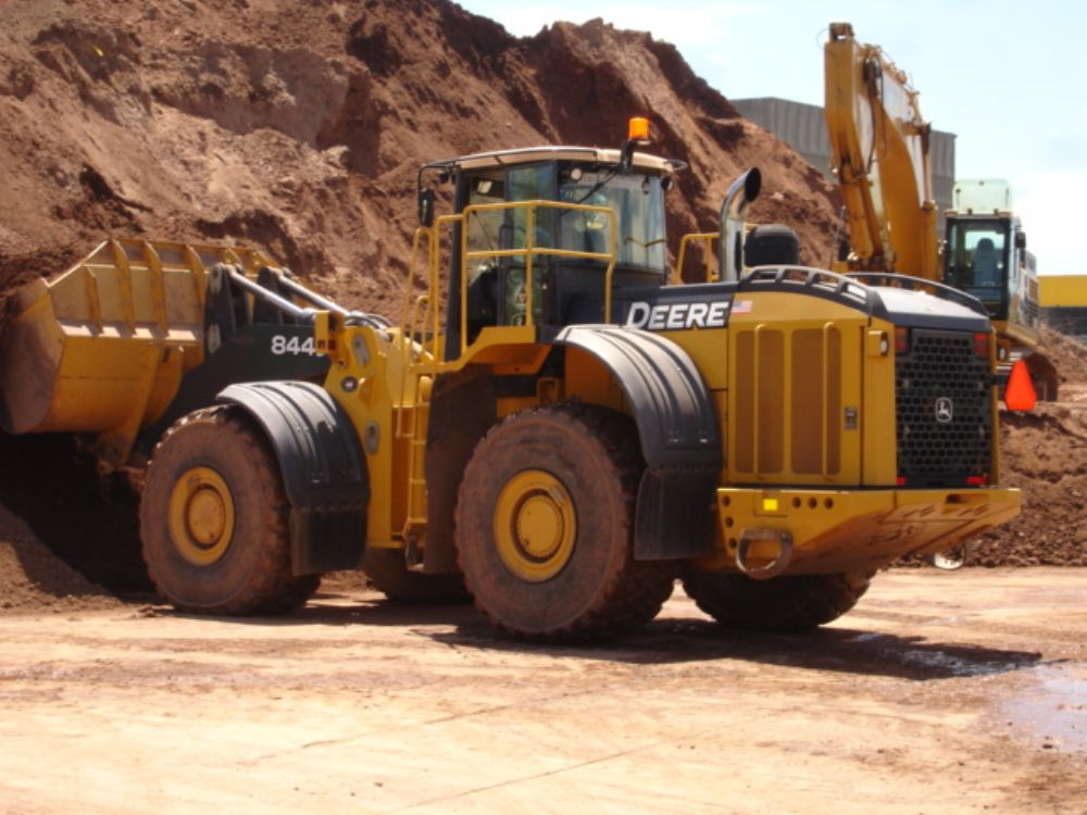The RSA (reusable stockpile area), is about 5 acres big and is used to house materials from contractors that can be reused onsite. RED Technologies uses a John Deere 844J wheel loader, purchased from W.I. Clark, to load up any trucks at the RSA.