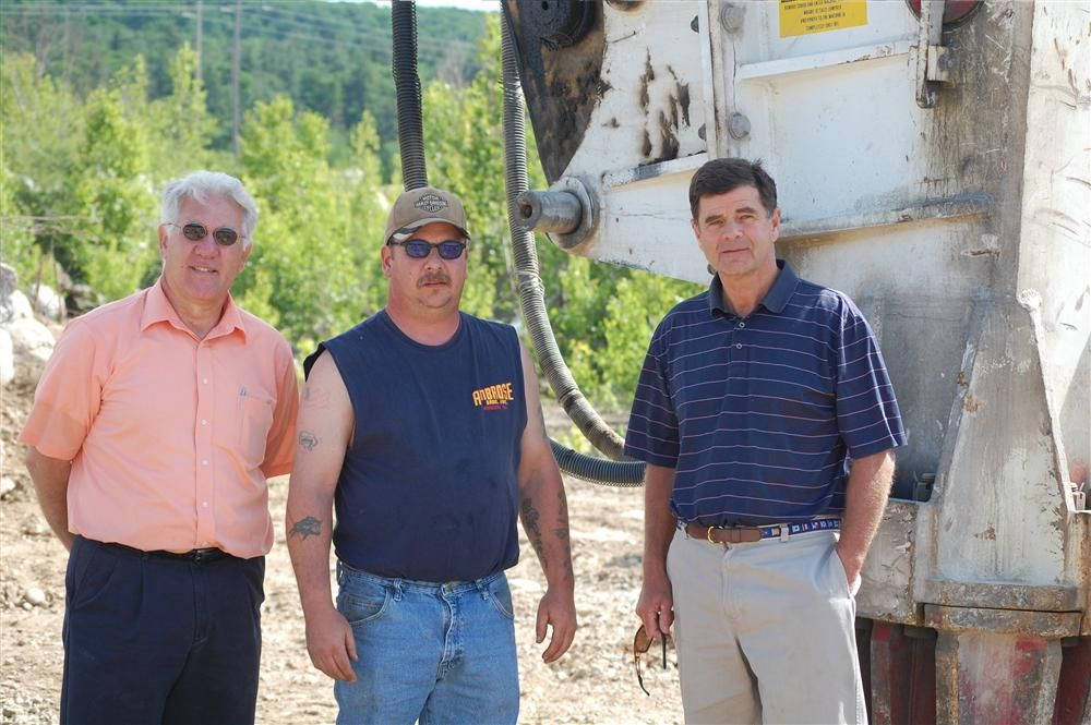 (L-R) are Doug Baker, sales representative of Whitney and Son; Joe Ballou, Ambrose Brothers equipment operator; and Bob Ambrose, owner of Ambrose Brothers.