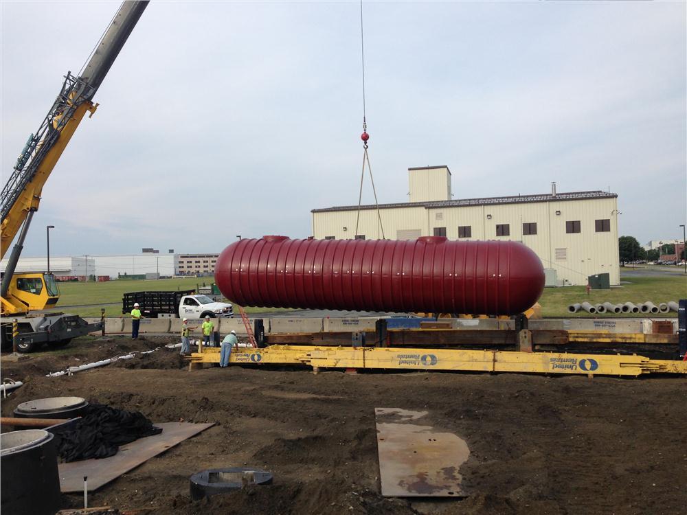 Crews install a 25,000-gallon holding tank.