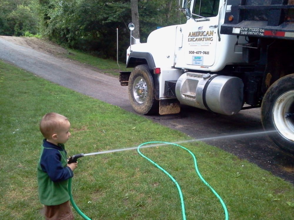 The Souza's three-year-old, Wyatt, helps Dad wash the big trucks when Dad comes home, and has helped them land jobs.