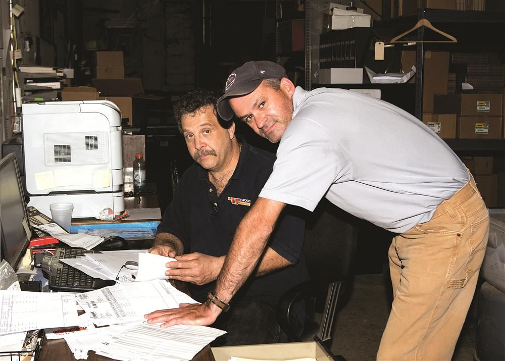 Paul Alagna (L), shipping and receiving, consults with PSSR Sam McRell.