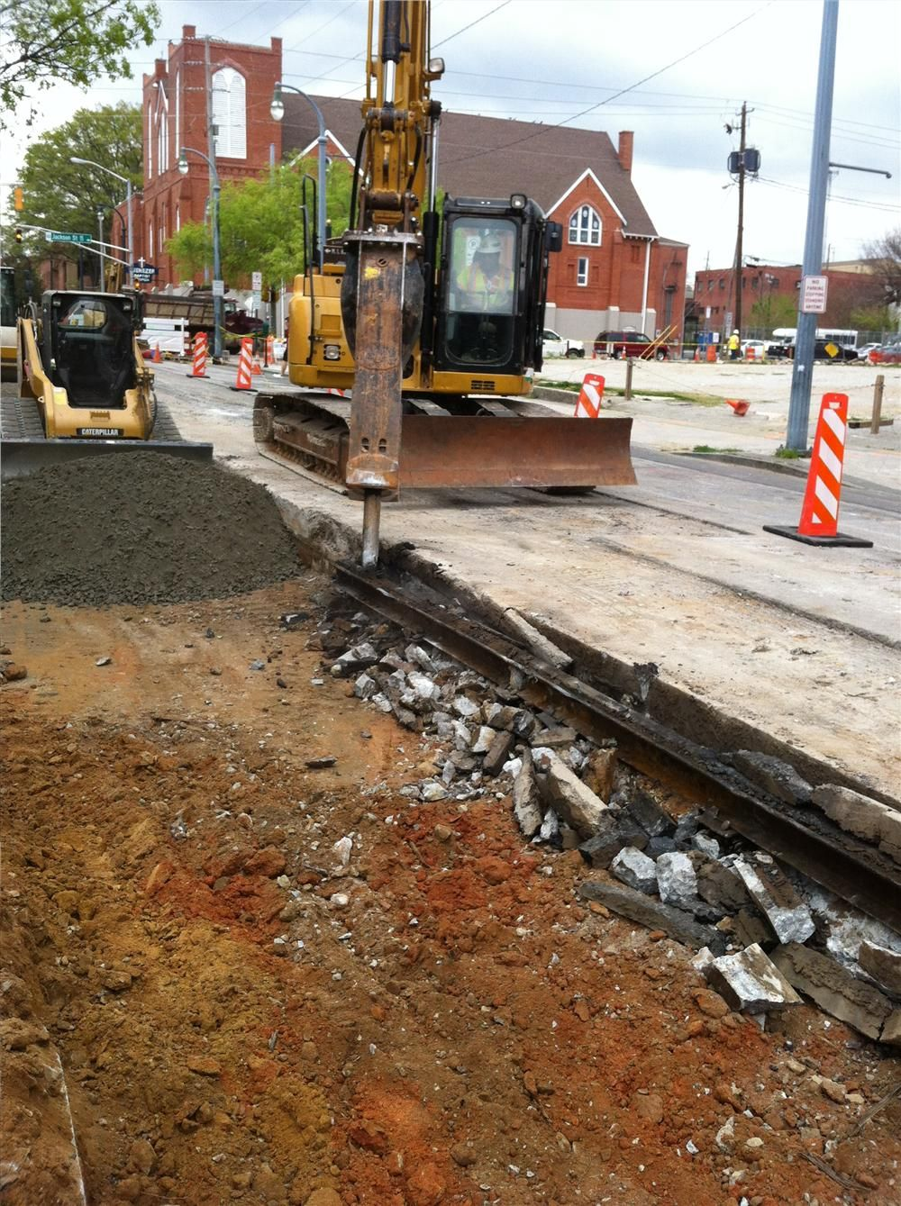 (URS team photo) A construction worker places aggregate base for the new streetcar line.