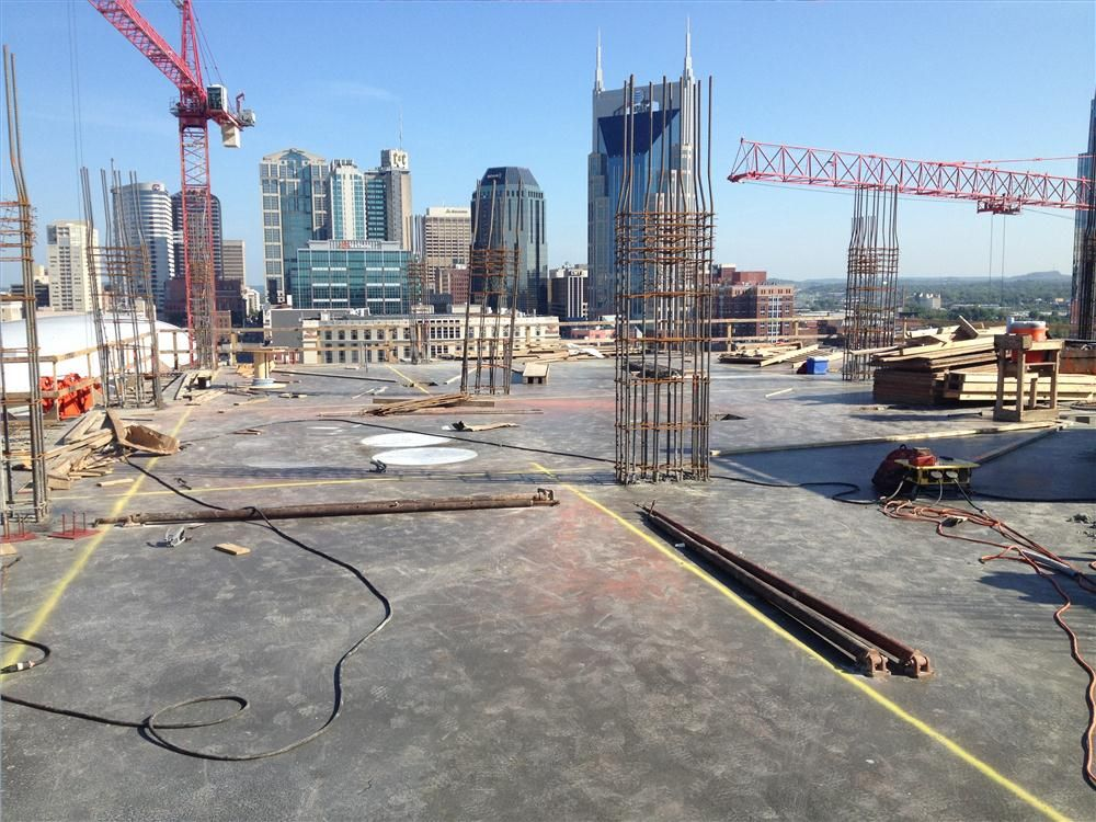 Equipment used for the project includes tower cranes and buck hoists for lifting materials into the building.