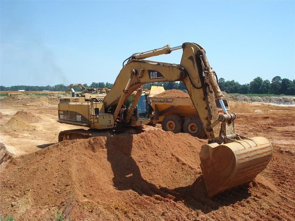 Glover Construction Company prefers to use larger Caterpillar 385C excavators to load its Volvo A40G trucks.