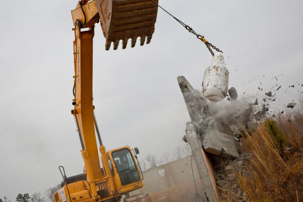 (Raftermen Photography) The wrecking ball is the preferred method for demolishing the concrete structures on site because it allows for a better separation of the reinforcing steel from the concrete.