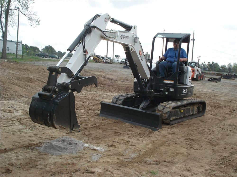 A guest tests his machine skills on a Bobcat E45 excavator during the operator rodeo.