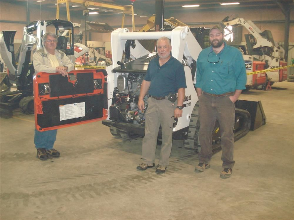 (L-R): Greg Taylor, Steve Collins and Nathan Taylor, all of Collins Hammett Construction in Greer, S.C., discuss the serviceability of the Bobcat T750.