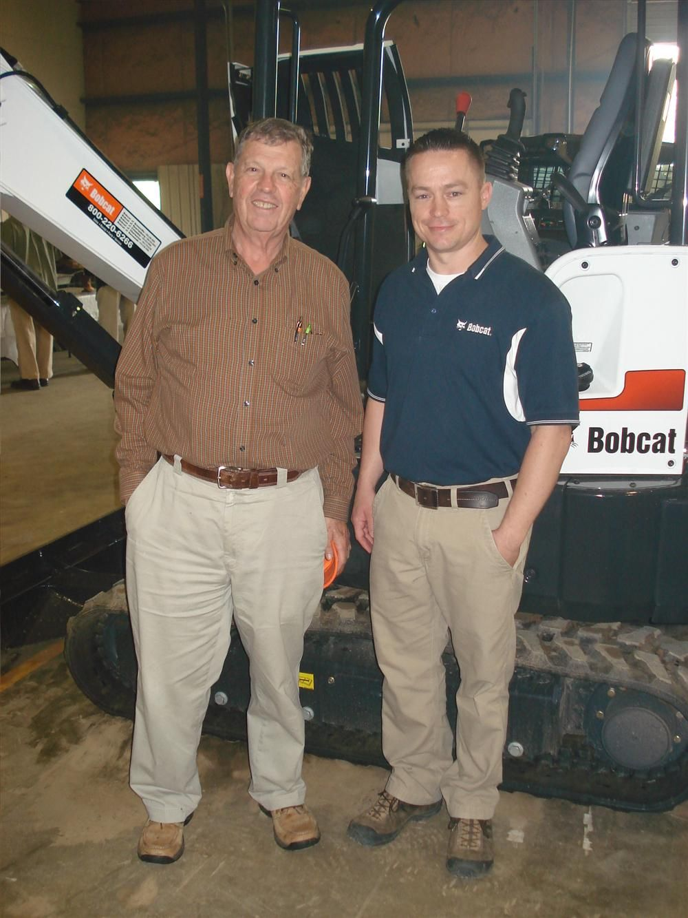 Frank Nutt (L) of The Nutt Corp in Moore, S.C., and Freddie Blanton of Bobcat in Spartanburg examine the Bobcat E32 excavator.