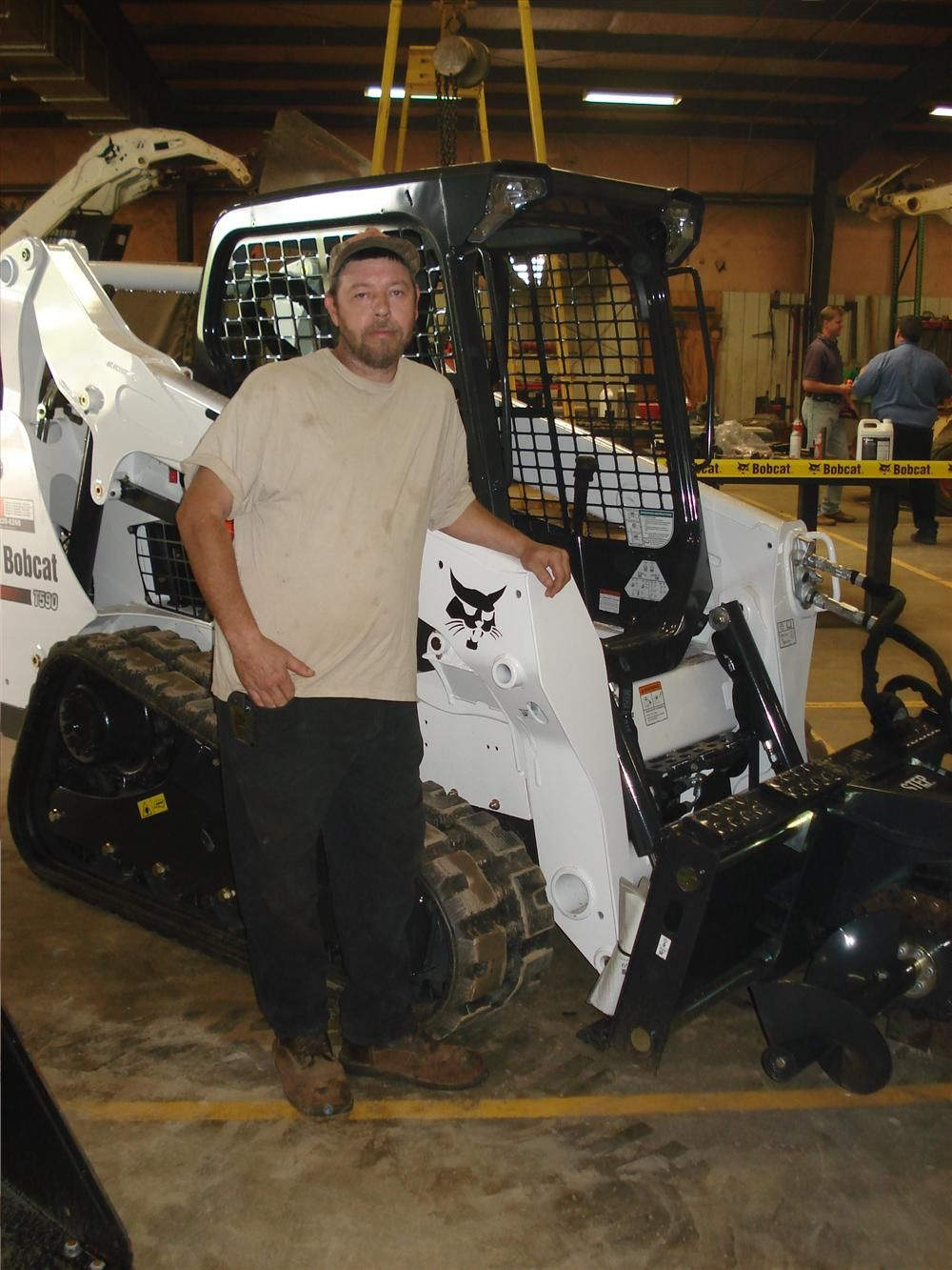 Chris Turner of George White Construction in Cowpens, S.C., spends time looking over the T590 Bobcat track loader.