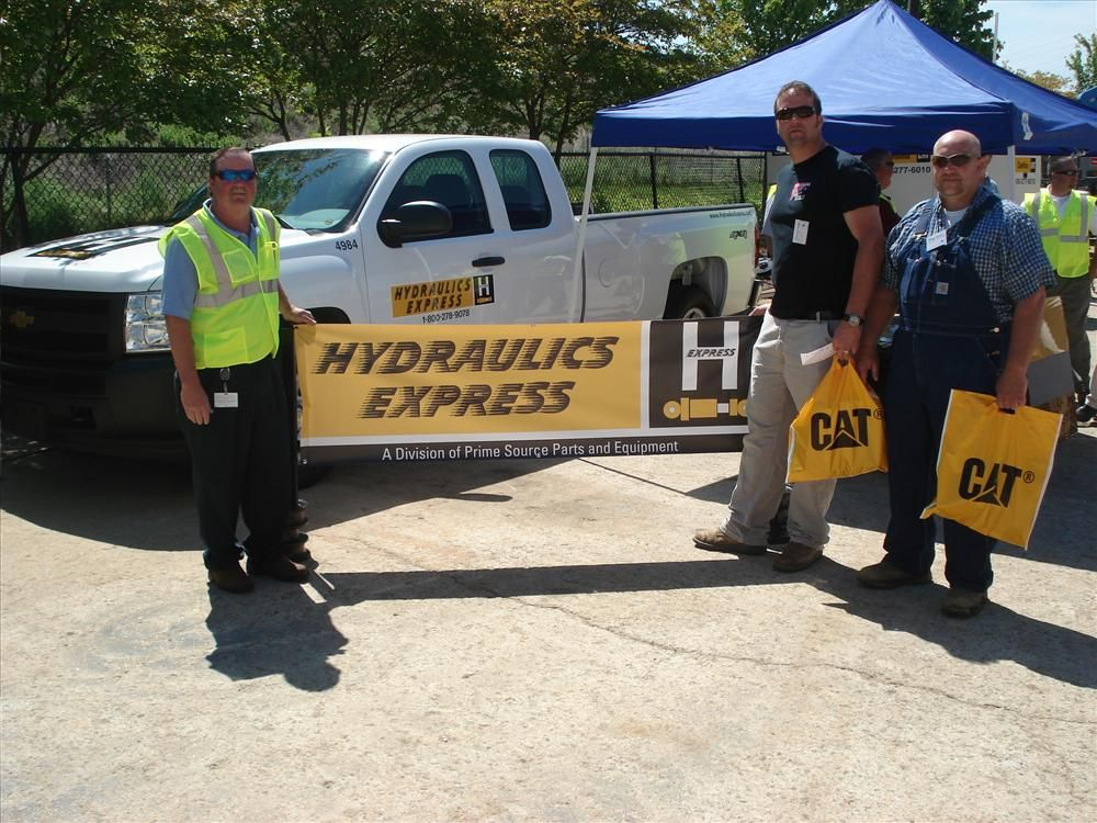 (L-R): Bobby Tolley of Carolina CAT talks about Hydraulics Express with Danny Eaton of Eaton Plumbing in Trinity, N.C., and Steve Skeen of Skeen Land Services in Trinity, N.C.