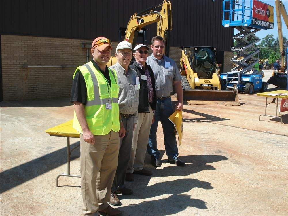 (L-R): Mike Henderson of Carolina CAT tells Bob Idol of JW Hampton in Boone, N.C., Johnny Hampton of Hampton Grading in Boone, N.C., and John Crevar of Hall Contracting in Charlotte, N.C., about services offered by Carolina CAT.