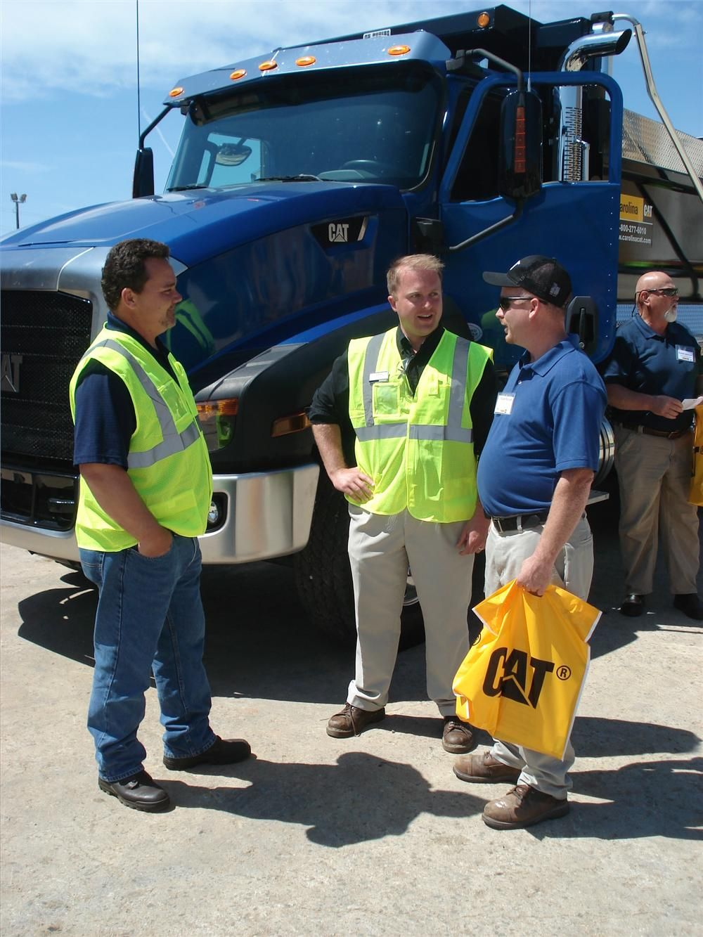 (L-R): Randy Ellison of Carolina CAT, Steve Goggins of Cat and Adam Keziah of Johnson Concrete Company in Salisbury, N.C. stand in front of the Cat CT660 vocational truck.