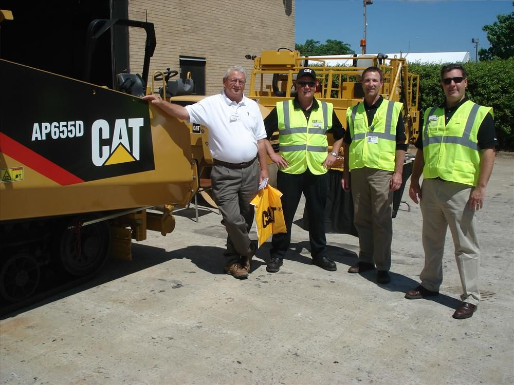 Carolina CAT offers complete paving solutions representing Caterpillar, Rosco, LeeBoy, Gomaco, Weiler and other quality brands. Shown are (L-R): Lucky Darnell of Cactx Surfaces in Winston-Salem, N.C., is helped by Dane Bambach, Gordon Johnson and Jonathon