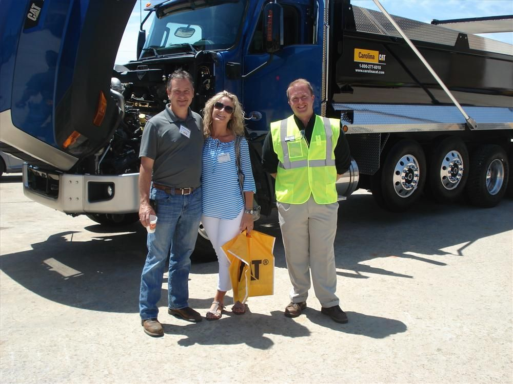 William and Sheila Smith of WD Smith Grading in Monroe, N.C., talk to Steve Goggins of Carolina CAT about the Cat CT660 vocational truck.