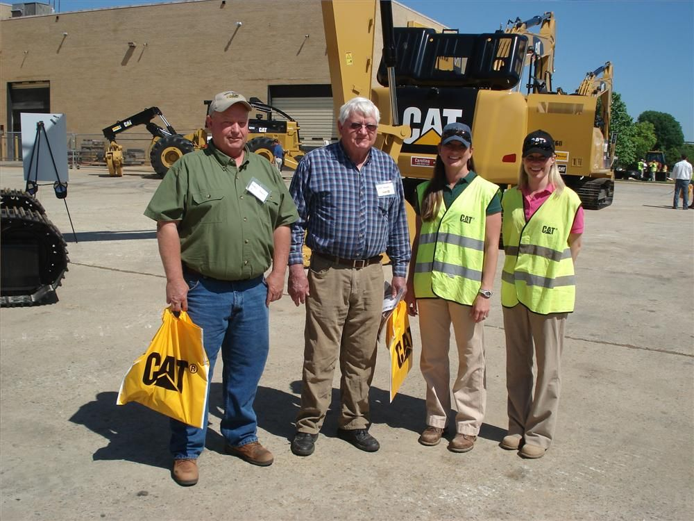 (L-R): Bobby and Ira Howell both of Howell Grading in Midland, N.C., and Jenelle Strawbridge and Allie Beck both of Caterpillar go over the Cat 324E L.
