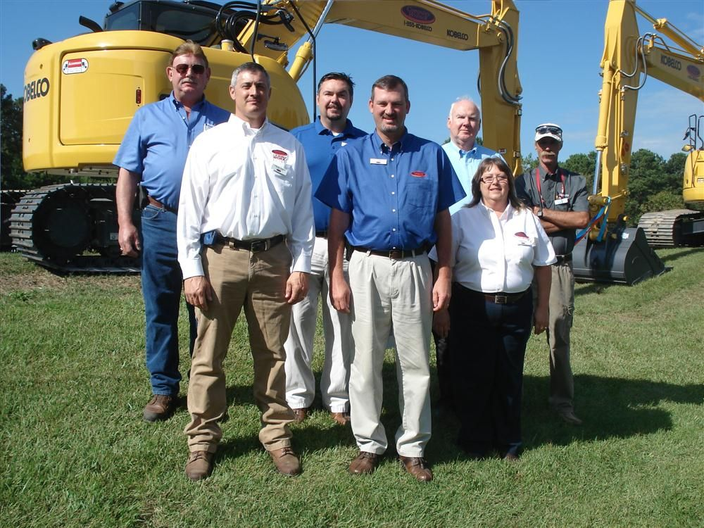 (L-R, front): Tom MacGibbon, Scott Carpenter and Debbie Agee all of Company Wrench; (L-R, back): Terry Gaylord, Matt Csoka, George Lumpkins and Wes Brubaker all of Kobelco, stand in front of Kobelco equipment.