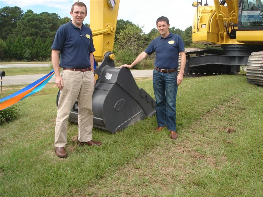 "Mick Crimmins (L) and Sean O'Reilly both of Strickland look over a 48"" Strickland bucket mounted on a Kobelco SK260LC excavator."