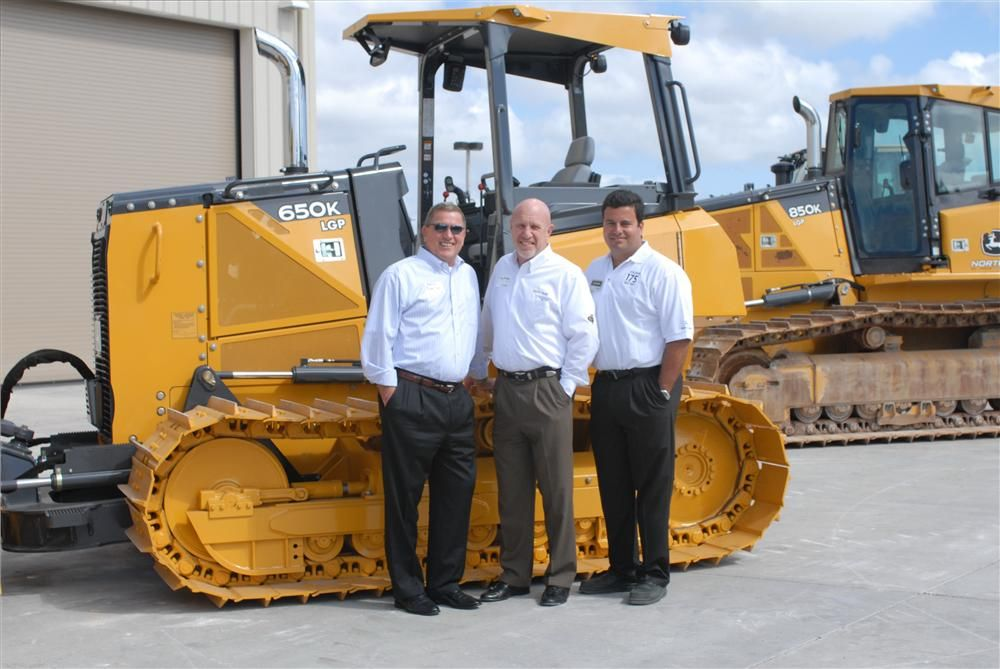 (L-R) are Kevin Karlix, John Deere director sales, United States and Canada; Tim Murphy, Nortrax president and CEO; and Eny Sanchez, Nortrax general manager, Nortrax Miami.