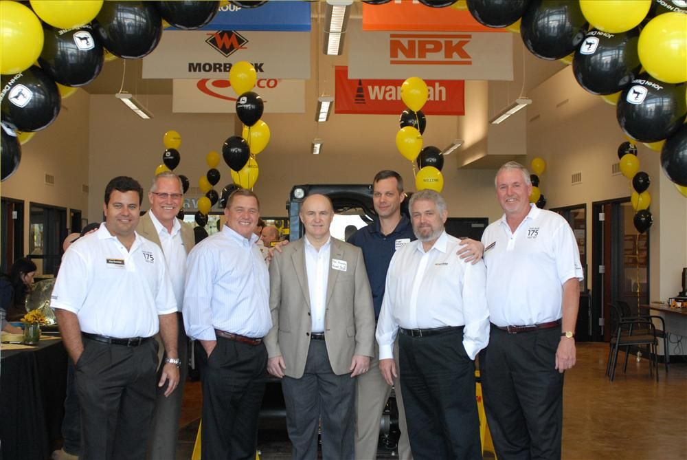 (L-R) are Eny Sanchez, Nortrax general manager, Nortrax Miami; Robert G. Miller, John Deere facilities engineer; Kevin Karlix, John Deere director sales, United States and Canada; Tom Fennelly, Russell Construction Co. Inc. vice president; Ryan Andresen,
