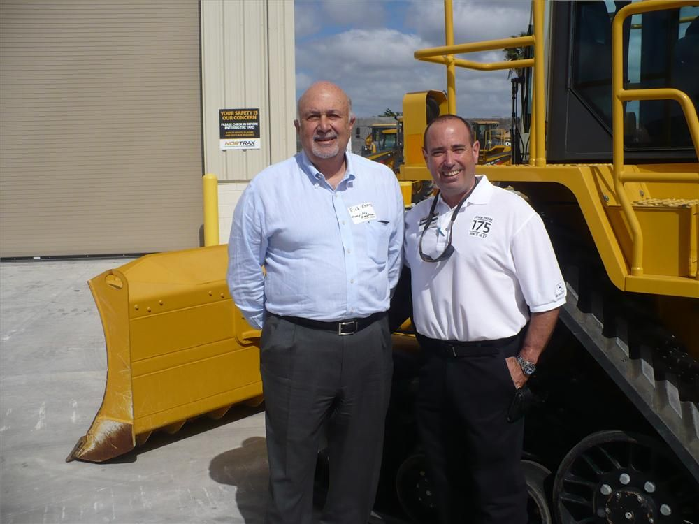 Rick Espino (L) of Condotte America is shown the Deere 764 high speed dozer by Carlos Rodriguez of Nortrax.