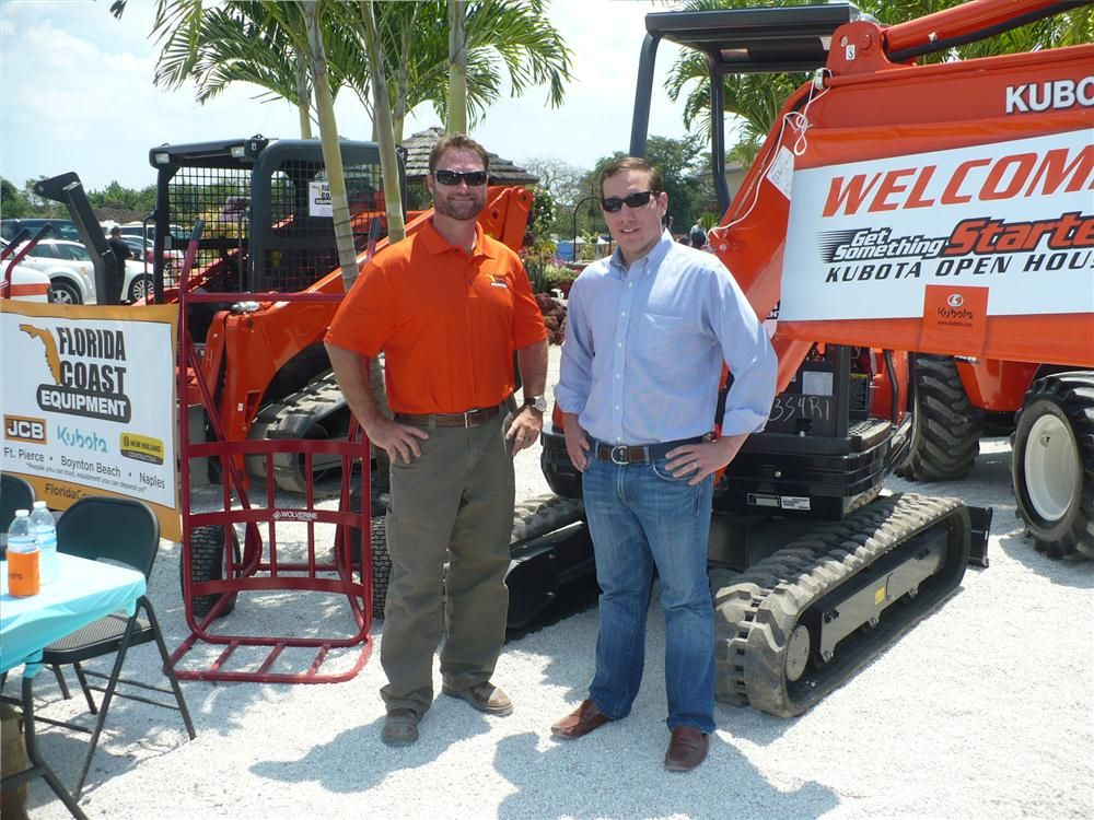 Mike Blann (L) of sales and Todd Bachman, president of Florida Coast Equipment, get ready for the event.