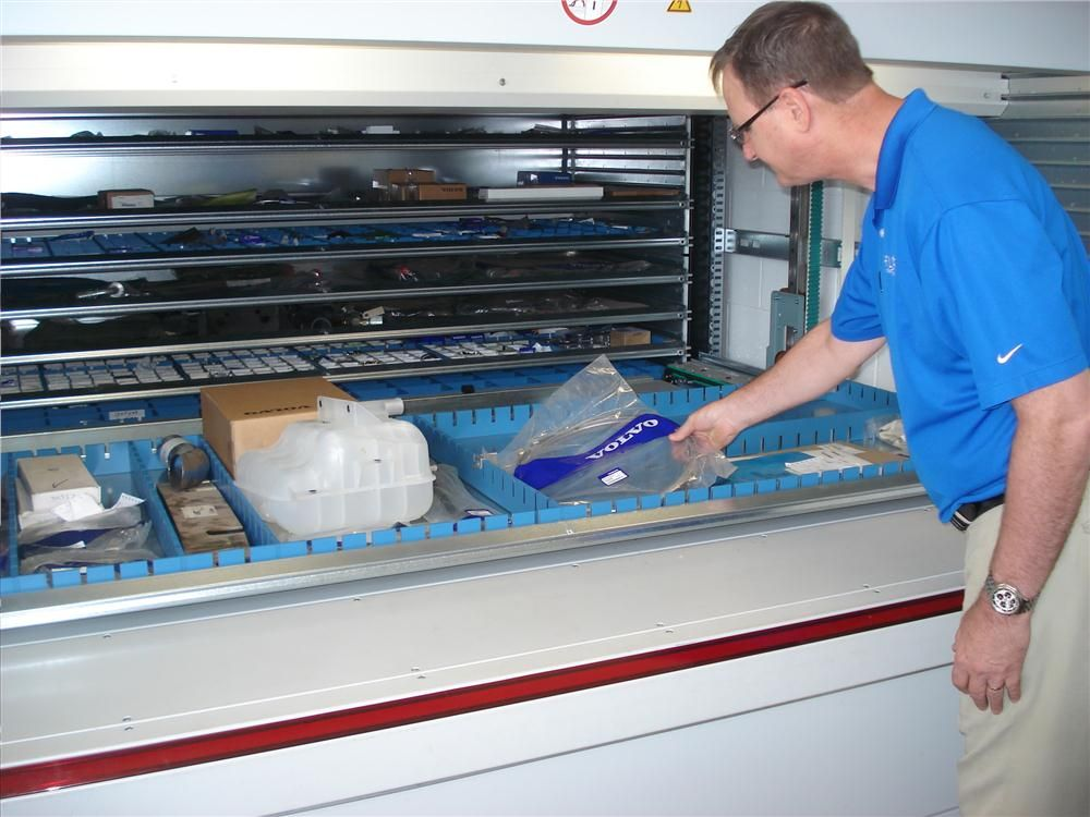 Alan Olson, parts manager in Tampa, pulls a part from the Remstar storage system.