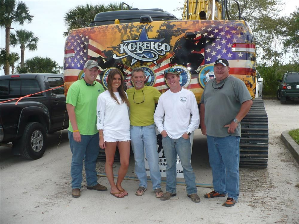 (L-R): Billy Levin, Volusia County Sheriff's department; Caroline Burkhalter, ADP; Tommy Marks, Great Southern Equipment; Eric Templeton, Sims Crane & Equipment; and Dave Willis, Great Southern Equipment, stand in front of the Kobelco Wounded Warrio