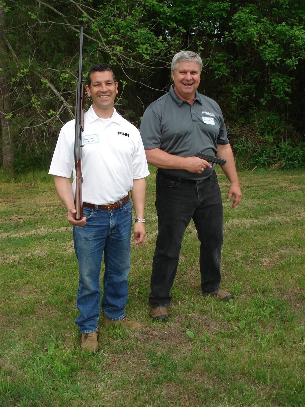 Ron Ciolfi (L) of Finn uses his Remington 1100 12 gauge, while Randy Hall of Eager Beaver Trailers uses his Glock model 22, a 40 caliber pistol.