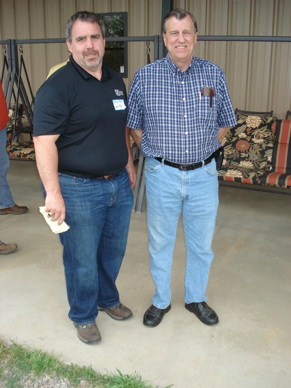Terry Thomas (L) of James River Equipment welcomes Steve Burleyson of Blythe Construction.