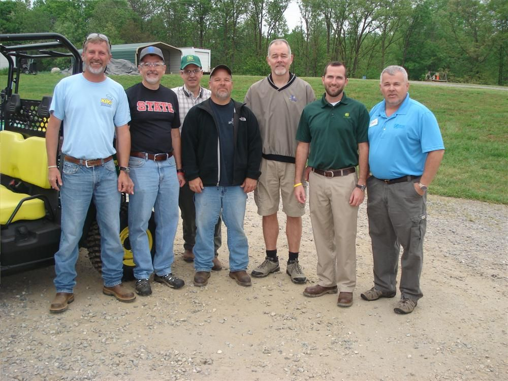(L-R): Marty and Jeff Greene of KRG Utility in Lenoir, N.C.; Emerson Crawford of SKA Consulting Engineers; Bobby Bald and Jeff Denny, both of the city of Greensboro; Scott Knox of John Deere; and Ronnie Rowe of James River Equipment, talk about the event.