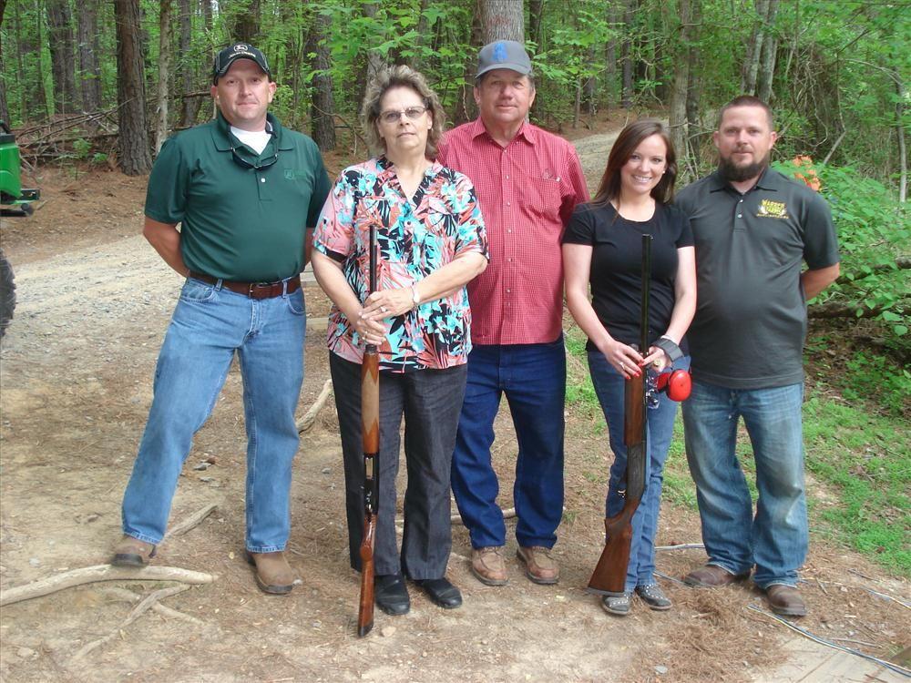 Mookie Leftwich (L) of James River Equipment talks (L-R) with Nancy and Jerry Warren, Laci McCauley and Steven Warren, all of C&J Utilities Inc. in Burlington, N.C.