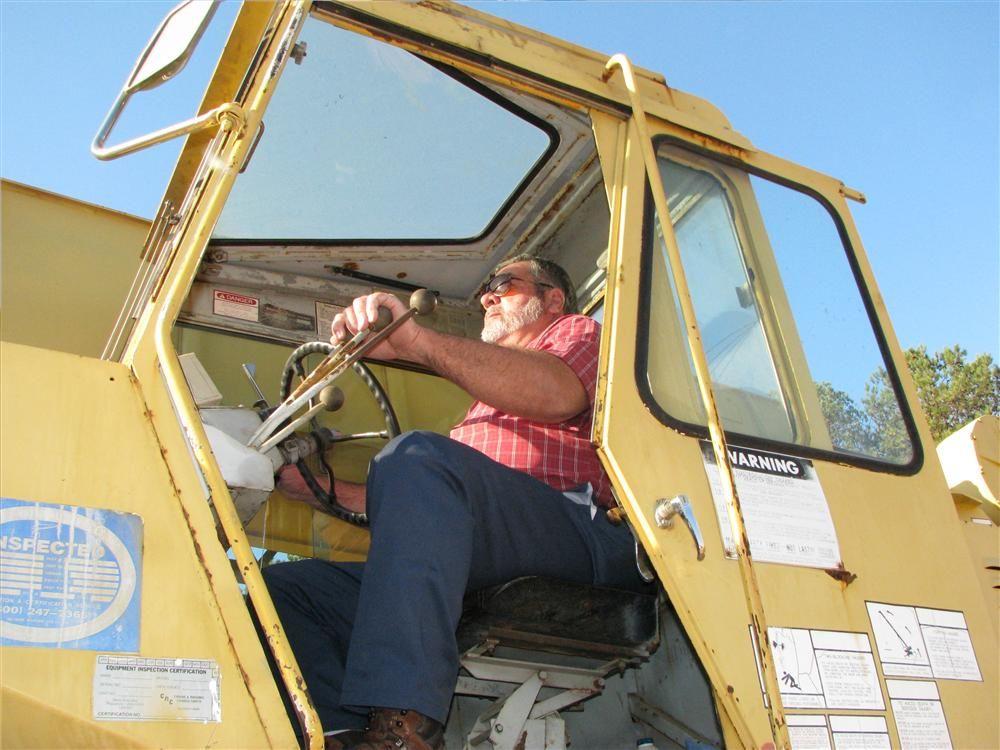 Steve Woodard, Woodard Construction Company, Ozark, Ala., tests a Grove crane in the sale lineup.