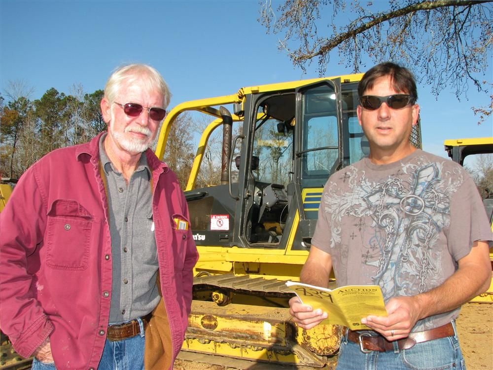 Taking a moment to discuss machines of mutual interest are Allan Harbison (L), Triple H Farms, Arley, Ala., and Richard Densmore Densmore Excavating Inc., Arley, Ala.