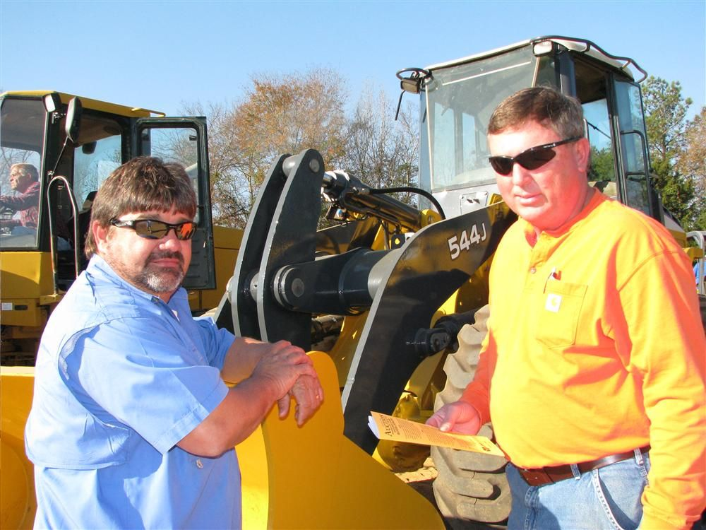 Cliff Sizemore (L), Ameri-green, Americus, Ga., and Gary Powell, Country Vista, Buena Vista, Ga., were interested in some of the Deere machines, including this 544J wheel loader.