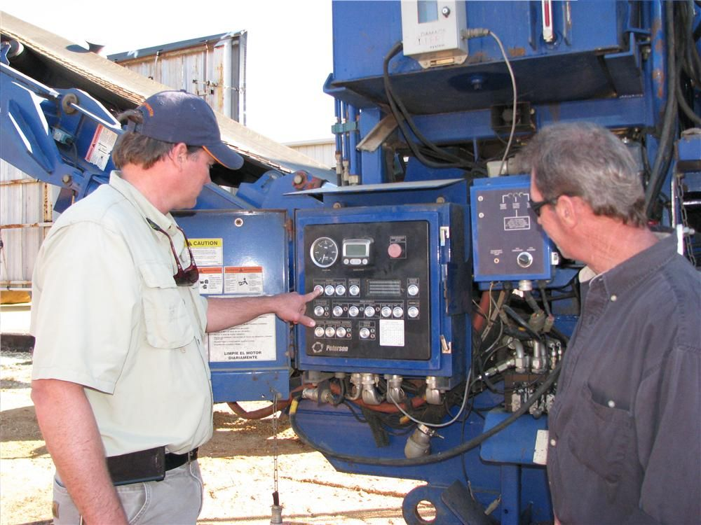 Checking out the control panel of a Peterson 4710 horizontal grinder are Malcolm Smith (L), Conecuh Timber, Beatrice, Ala., and Tim Lynch, Northside Equipment, Arab, Ala.