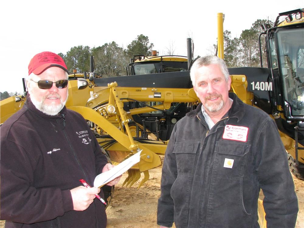 A nice package of nine Caterpillar 140Ms caught the attention of Jerry Adams (L) and Barry Miracle of RJ Corman Railroad Group Contractors, Nicholasville, Ky.