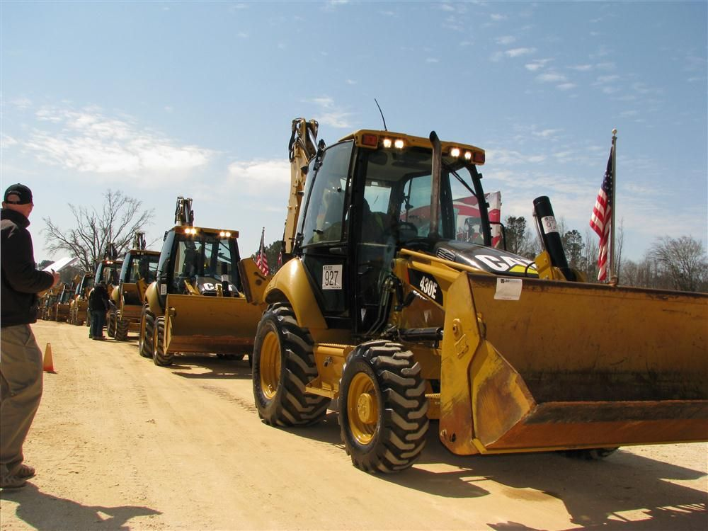 Some nice iron rolled across the ramp on day two of the three-day sale, including this package of eight 2010 Caterpillar 430E backhoe loaders.