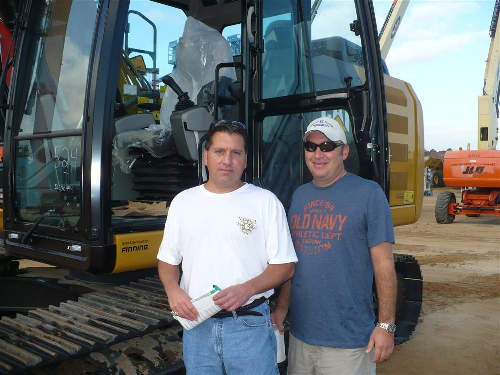 Bill Keefe (L), and Bill Fuchswanz, Triple E Equipment, were looking at a wide variety of equipment including this Cat 320E excavator.