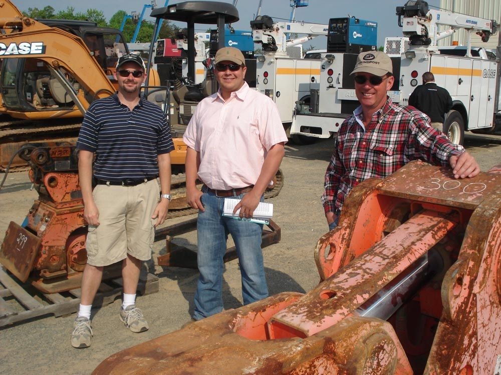 (L-R): Steven Nethery, Artec Tractor and Equipment, Nauvoo, Ala.,; Lee Mashburn, Mashburn Equipment, Ringgold, Ga.; and Jerry Hawthorne, also with Mashburn Equipment, were interested in the attachments that were available.