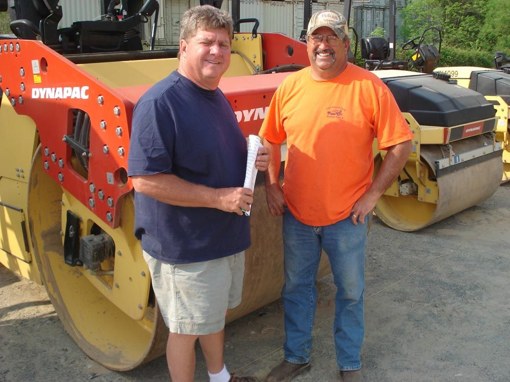Looking for a few rollers for the project they just landed are Dale Rose (L) and Randy Call, both of Carl Rose & Son Paving, Elkin, N.C.