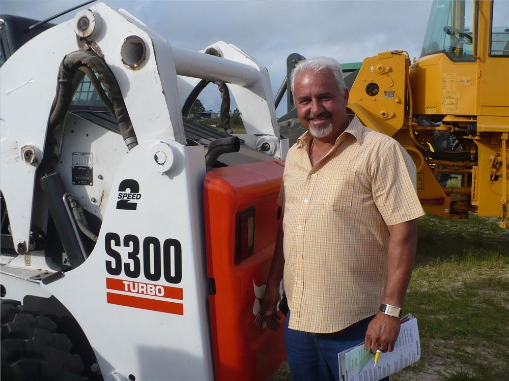Juan Ruiz of 4R Equipment in Miramar, Fla., inspects this Bobcat S300.